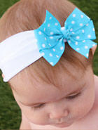light blue bow on white nylon headband on childs head