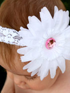 White lace headband and white flower on childs head